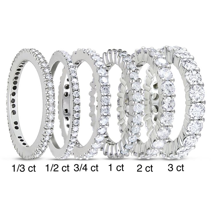 <li>Round-cut white diamond eternity band</li><li>This ring is available in <b>size 5 only</b></li><li><a href='http://www.overstock.com/downloads/pdf/2010_RingSizing.pdf'><span class='links'>Click here for ring sizing guide</span></a></li>