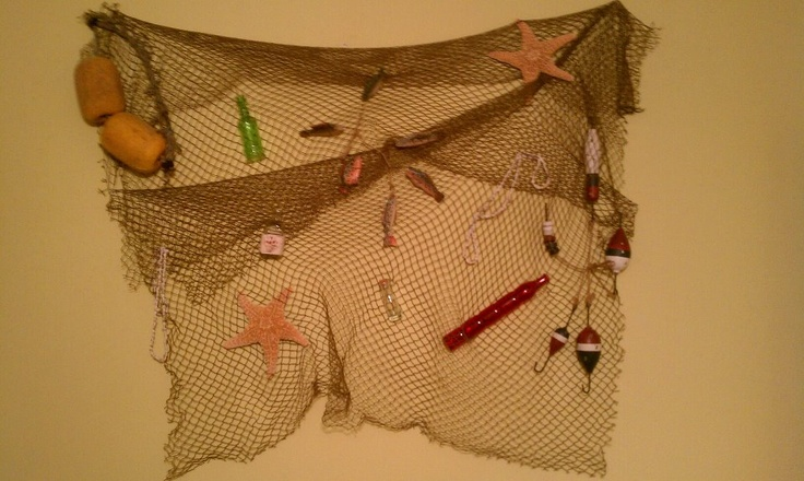 I designed this to  go above a queen size bed. I bought the nets from Hobby Lobby for only about $4.99 each. it took me a while to hang them to make it look good and then I just bought a ton of junk to hang in the net from Hobby Lobby.