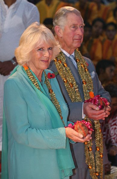 Camilla, Duchess of Cornwall and Prince Charles, Prince of Wales are presented with a gift as they take part in an Aarti ceremony at the Parmarth Niketan Temple on day 1 of an official visit to India. 6th November 2013