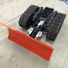 Snow Plow Robot | Let's Make Robots! | This is my snow plow bot. It is currently RC but I want to convert it to wireless for internet control.Weighs about 200 pounds.