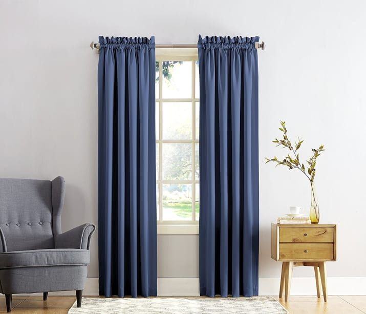 Block out the blinds ~and~ the sun with blackout curtains.Get it on Amazon for $13.30 (available in 28 colors).