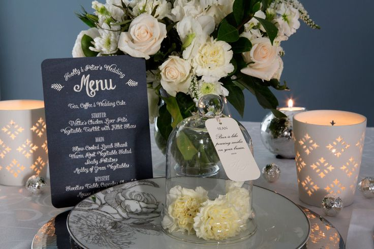 Elegant white and ivory wedding table settings. Ivory cotton paper. Embossed detail.  Place-card tags. Chalkboard menu. Flowers by Diamonds & Pearls Event Styling. Photography by Rikki Hibbert.