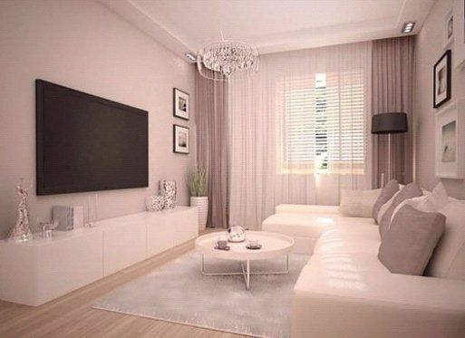 Wohnzimmer in weiß und beige gehalten - Home Entertainment System in ...