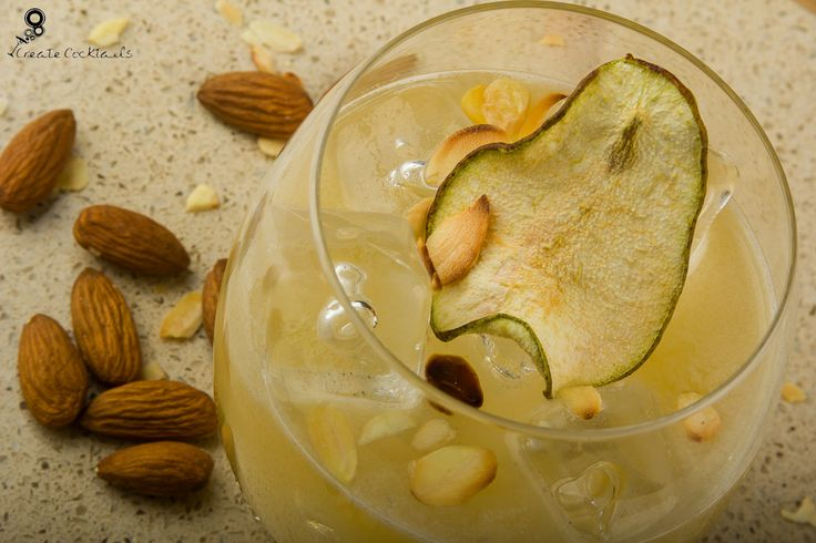 Broken Shaker: Tequila shaken with pear juice, agave, fresh lime and almond. Served in a martini glass and garnished with toasted almonds & fresh pear