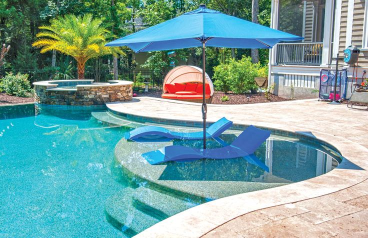 This pool has a tanning ledge-perfect for those who want the cool of the pool while they tan in the sun.