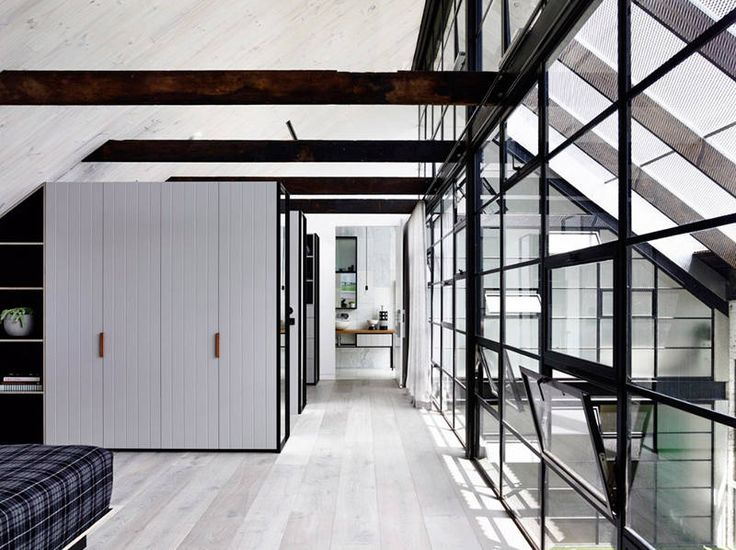 Like a new industrial skeleton within an old brick skin, this 250m2 warehouse conversion in inn...