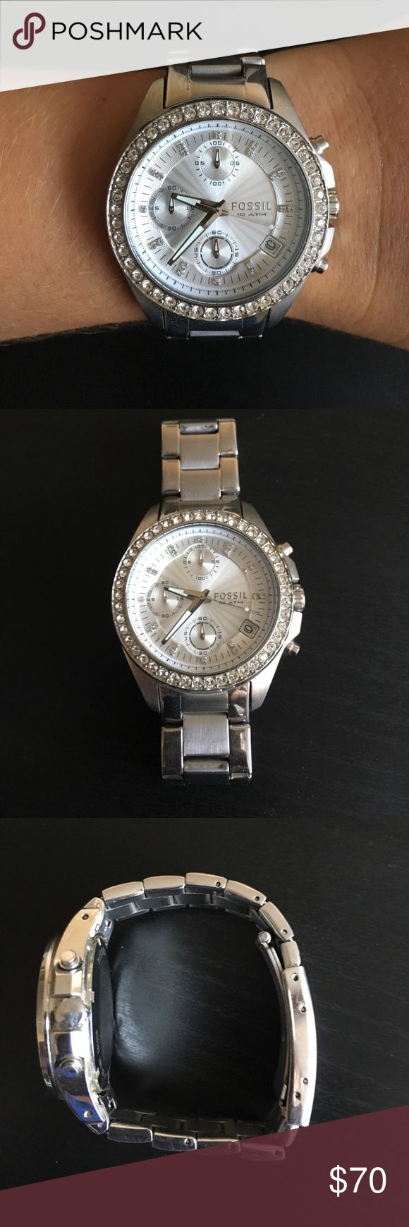 Silver Fossil Watch Silver fossil watch,  rhinestone accents and shows the date. Some scratches around the band from wear. Needs a new battery and currently fits a 6 3/4inch wrist but can be made smaller by removing links. Any watch shop can replace the battery and remove links! Fossil Accessories Watches