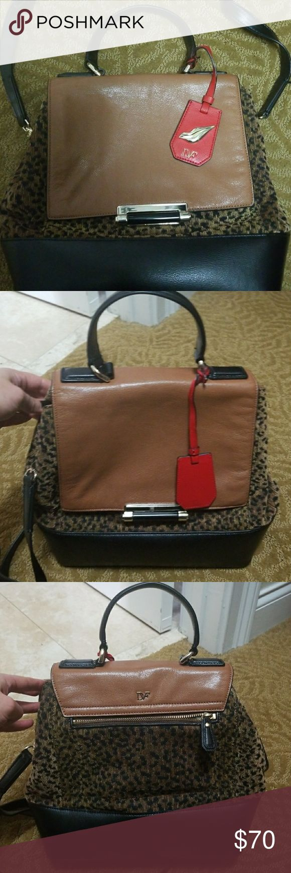 DVF Purse DVF. Tiger print. Leather and corduroy combo. Detachable shoulder strap. Like new. DVF Bags Shoulder Bags