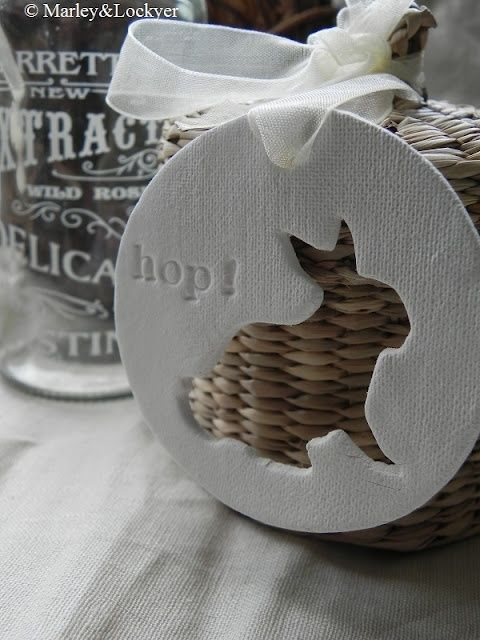 diy using salt dough or paper clay, cut a large circle and cut out the middle with a bunny cookie cutter