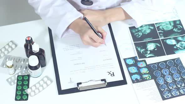 Doctor Fills Out Medical Prescription Forms