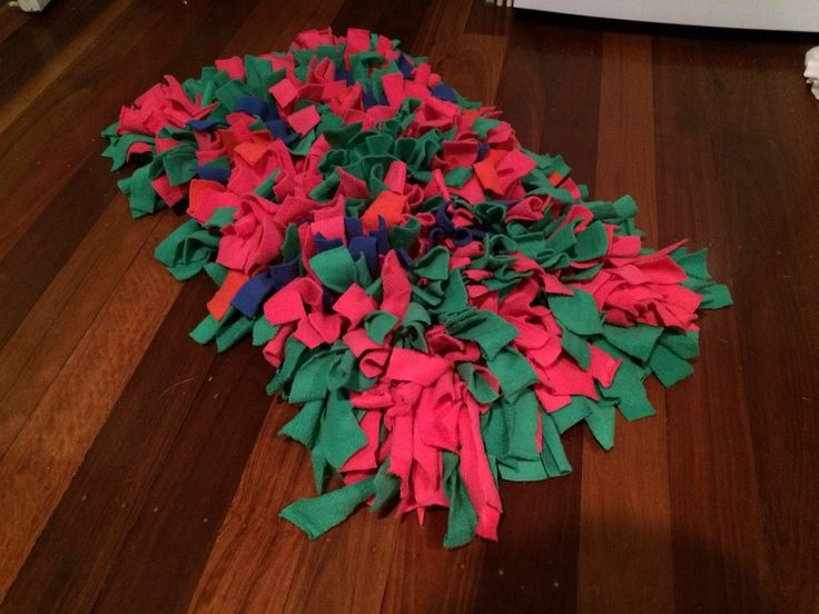 Snuffle Mat - encourages dogs to use their smell to find treats inside all the fleece knots!