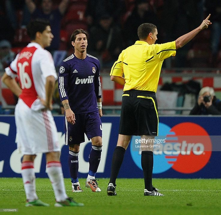 Referee Craig Thomson of Scotland sends off Sergio Ramos of Real Madrid for time wasting during the UEFA Champions League Group G match between AFC Ajax and Real Madrid at the Ajax Arena on November 23, 2010 in Amsterdam, Netherlands.