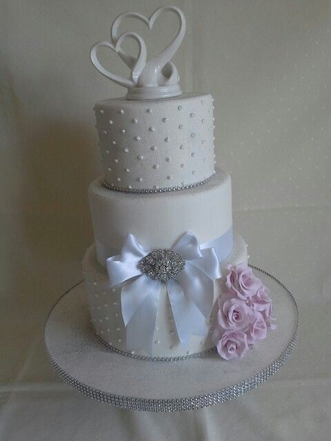 #White #bling #bows #hearts #pearl dots #silver shimmer & broach with pinky/purple roses created by MJ www.mjscakes.co.nz in sunny Hawkes Bay NZ delivered to the elegant  old church