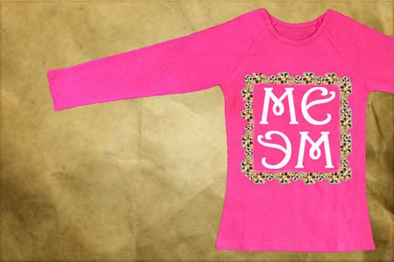 Pink long sleeved top with the white MEME print on the front. The print is framed with the white lace decorated with golden sequins.