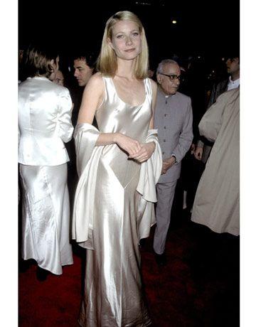Gwyneth Paltrow's Iconic Style  1995: Twenty-three-year-old Gwyneth Paltrow looks elegant beyond her years in an ivory satin, bias-cut sheath gown.