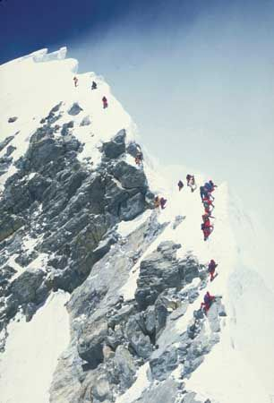 Bottleneck of climbers waiting to scale the Hillary Step (left centre) on May 10, 1996.  That is some scary sh**