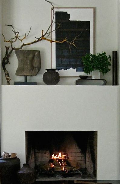 Love this idea for fireplace mantle; natural elements mixed with modern art