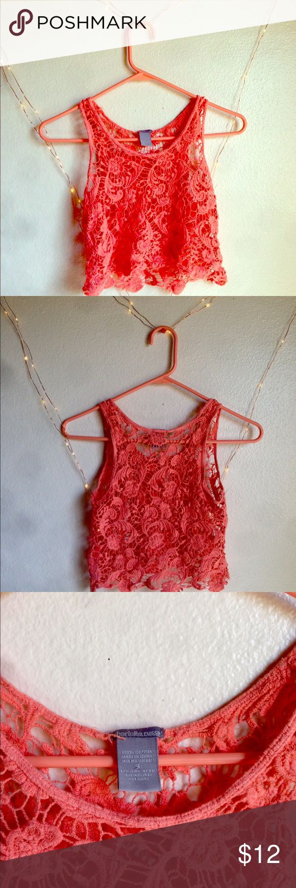 Crotchet Lacey Coral Crop Top Flowy bright crop top perfect for a beach day as bikini top cover or paired with a tank top inside to go with shorts. Be creative!  Fits true to size.  Please message me for more information if you're interested!  #guess #coral #creamy #layering #tanktop #beachbabe #beachwear #summer #fresh #cool #spring #lace #eyelet #sporty #stringytop #striped #yellow #white #cute #lovely #hot #chic #sexy #littlewhitetop #girly #floral #flowy #colorful #secretangels #openback…