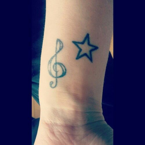 Music note and star tattoo on wrist