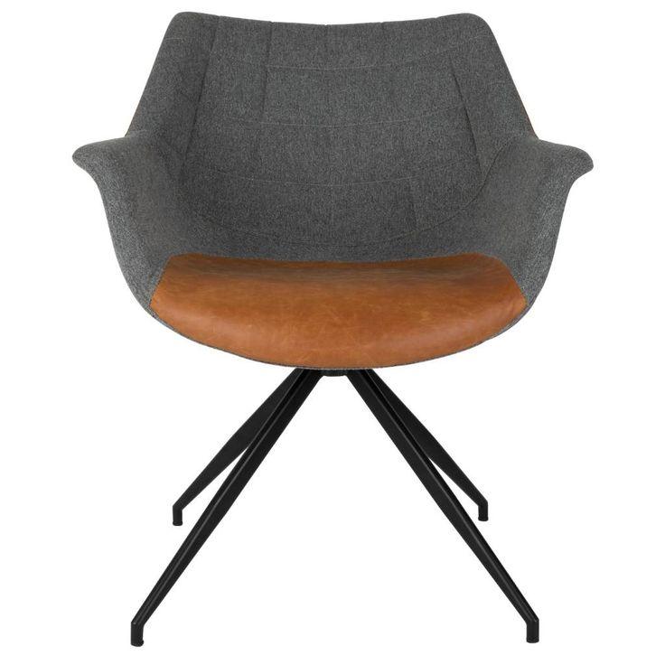 Deze sportieve eetkamerstoel van Zuiver heeft een stoffen kuip met armleuningen. Op de zitting en de rug zit een contrasterende kleur in imitatie leer. De Doult
