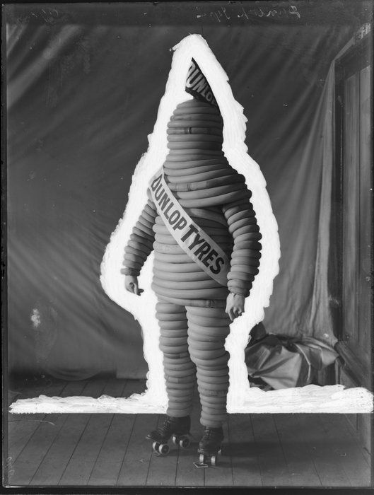 Dunlop Tyre Man figure in rubber costume, on roller skates, 1911. Ref: 1/1-009249-G  Photograph taken by the Steffano Webb Photographic Studio, Christchurch