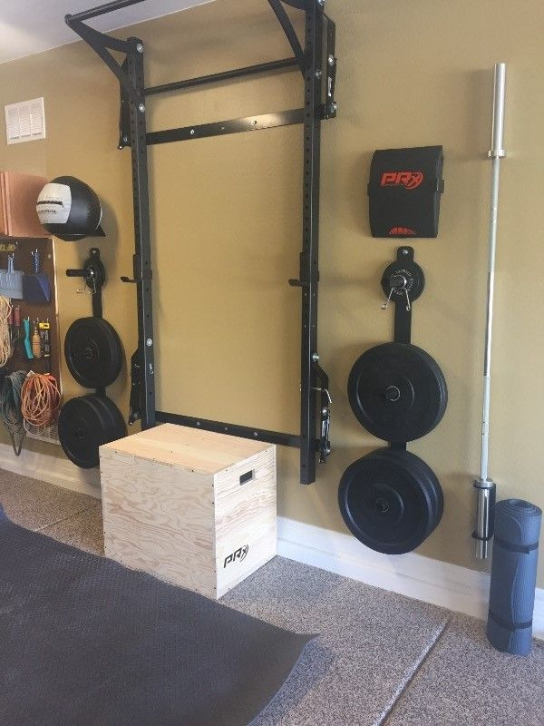 Transform your garage with the Women's Profile® Home Gym Package. Everything you need surrounds the patented wall-mounted folding Profile® Squat Rack with Kipping Bar™. Ready to work out at home? Just