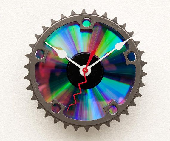 Clock made from a recycled Bike chainring and a DVD