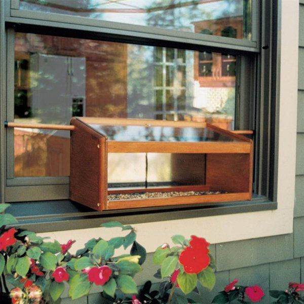 the mirrored windowsill feeder has two way mirrored panels that allow you to see the window bird