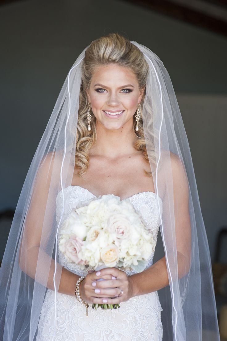 bride dress wedding down bouquet silhouette cathedral veil make-up hair half up half down