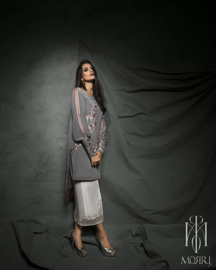 Jude- pewter grey adorned with floral vines . The accent culottes are embroidered with a touch of organza Pewter#grey#flowers#cuffs#sleeves#coldshoulder#culottes#pret