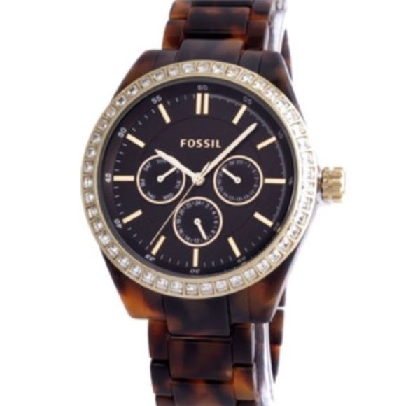 Fossil Tortoise Shell Watch Women's Fossil tortoise shell watch. Has acrylic band and chronograph feature in the face with a row of crystals around the bezel. One stone is missing - can easily be replaced. Besides for the missing stone, the watch has never been warn. Tags still attached and in excellent condition. Authentic! No trades! Fossil Accessories Watches