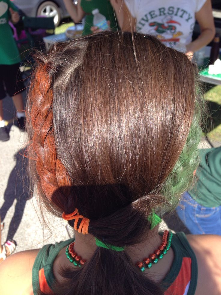Hairstyle for Miami Hurricanes game. Two braids sprayed