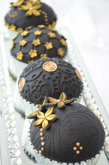Elegant black and gold embossed anniversary cupcakes