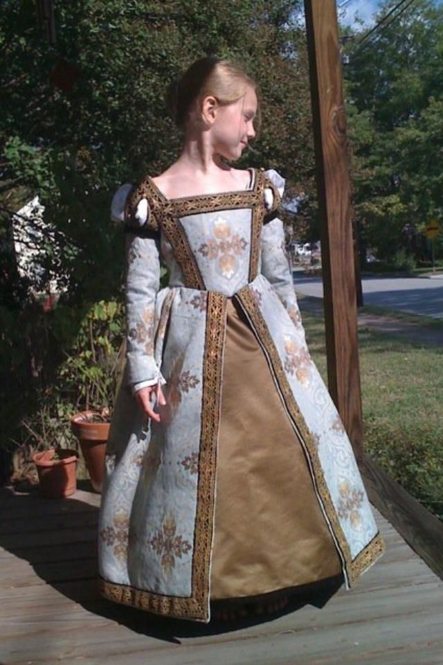 Young girl in 16th century Venetian gown.