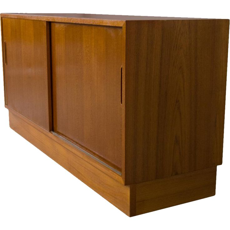 $895 - A fine quality teak buffet by Poul Hundevad. It measures 54.5 long by 17 deep by 26.5 tall. The finish is a rich amber color and in extraordinary