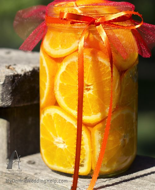 colorful...Mason jar filled with cut oranges.