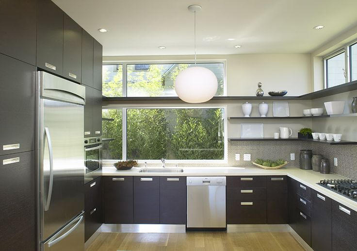 Dark cabinets, open shelving, & stainless steel appliances keep this kitchen modern.