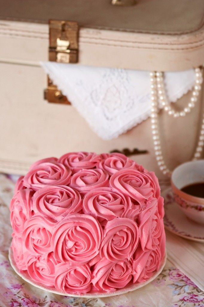 Strawberry cake with cream cheese buttercream frosting. This cake is made out of cupcakes!