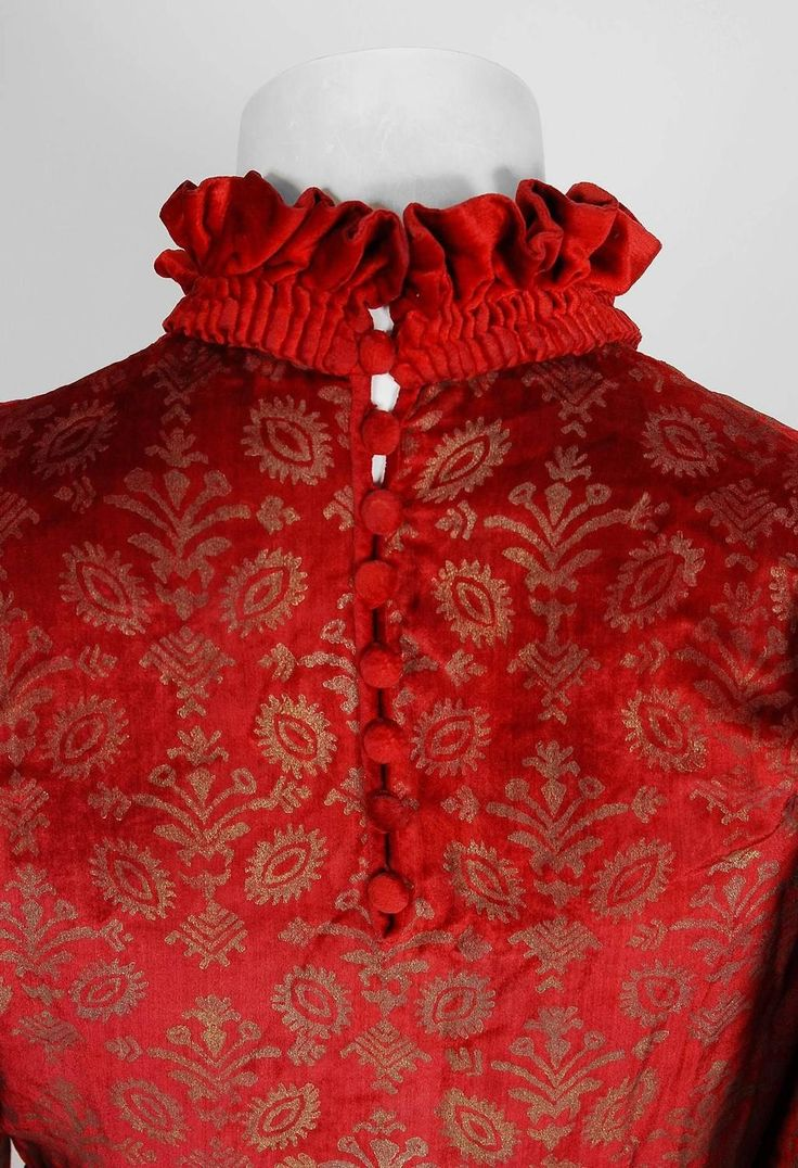 1920's Metallic Stenciled Red Velvet Angel-Sleeve Trained Gown care to place this garment together must have taken weeks. The luxurious heavily-pleated collar and waistband create a beautiful regal effect. My favorite detail is the dramatic winged angel-sleeves which Gallenga was known for. Throughout her career, she remained true to her original formula for stenciling on silk-velvet. She used as many as nine tones of gold and silver pigment to achieve the desired ombré shading