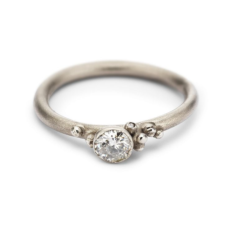 Antique cut white diamond solitaire engagement ring in white gold handmade in Ruth Tomlinson's London studio. Alternative engagement ring.
