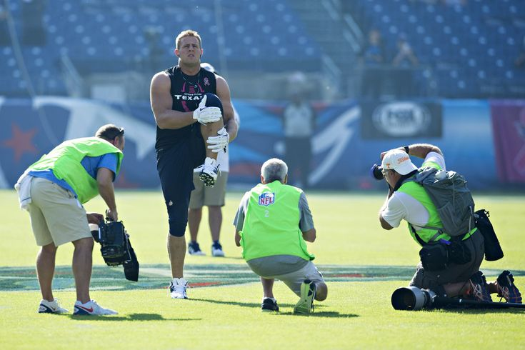J.J. Watt #99 of the Houston Texans warms up with cameras shooting before a game against the Tennessee Titans at LP Field on October 26, 2014 in Nashville, Tennessee.