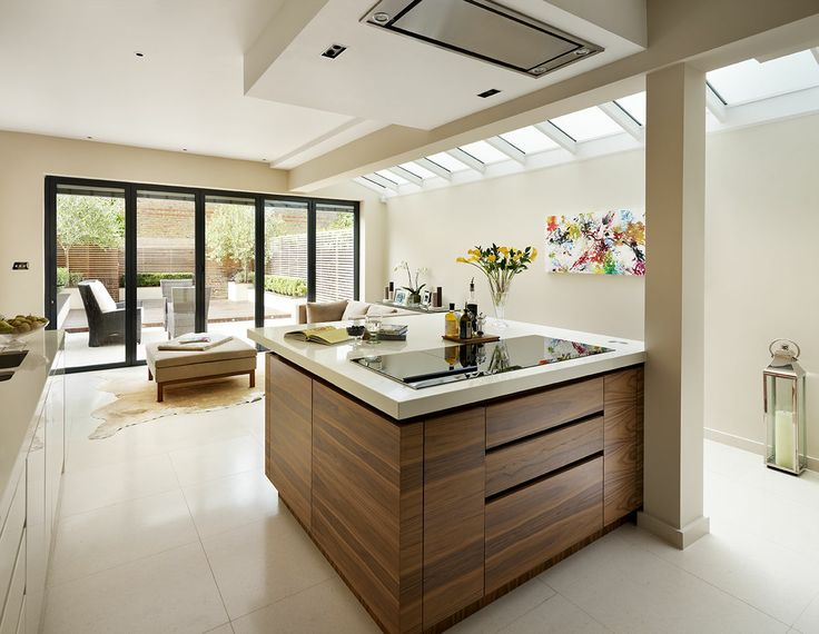 Like the wood tone of the island, and proportionate ceiling feature with lights and fan. Roundhouse bespoke Urbo kitchen