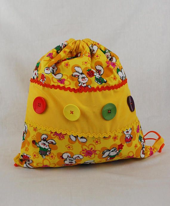 Preschool backpack, mini backpack, bunny print, drawstring bag, kids stuff, lightweight backpack, kids style, rabbit bag, yellow bag, button bag, baby girl bags, school supplies