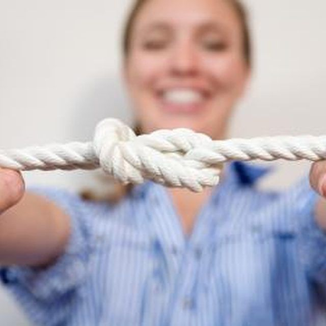 Kids must work together to untie knots in a team-building game.