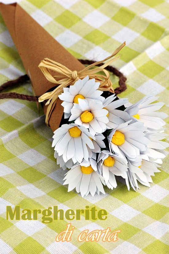 paper daisies in a kraft paper cone with twine