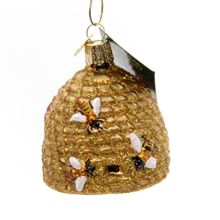 Old World Christmas Bee Skep Glass Ornament Height: 2.75 Inches Material: Glass Type: Glass Ornament Brand: Old World Christmas Item Number: Old World Christmas 12391 Catalog ID: 28320 New With Tag. M