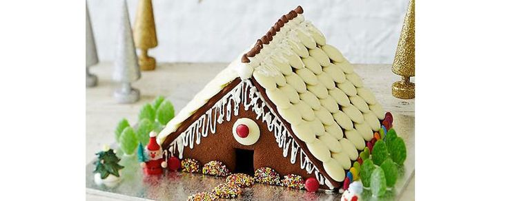 Christmas gingerbread house - make this adorable little house and brighten it up with colourful lollies including ALLEN'S FRECKLES! Recipe: https://www.bakers-corner.com.au/recipes/allens/choc-gingerbread-house/