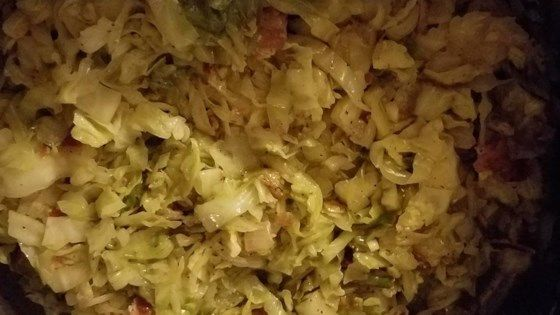 Fry sliced cabbage with bacon and bacon drippings and butter to produce this scrumptious side dish.