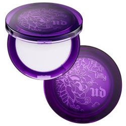 Urban Decay's De-Slick Mattifying Powder. Don't let the pale lavender color fool you; this baby goes on invisibly and works on every skin tone. Avoid shiny, slick skin this summer with Urban Decay's De-Slick Mattifying Powder.
