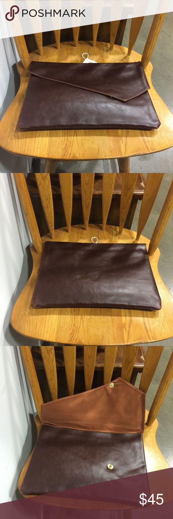 "Faux Leather Envelope Portfolio 14"" Brand new. Premium faux leather exterior. Flapover envelope snap closure. Microfiber lined interior. 14""W X 10""H X 1""D. - From Rich Mbariket, a men's shop at The Market LV at Tivoli Village Las Vegas Bags Briefcases"